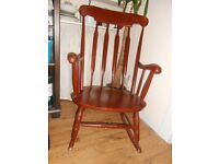 Sleek wooden rocking chair for sale