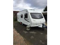 Lovely 2011 twin axle 6 berth touring caravan with awning