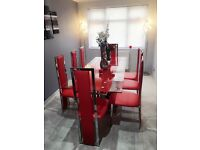 Red silver dining table with 8 chairs