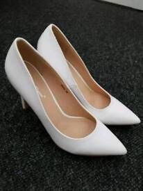 White stilletos size 6