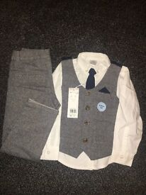 Brand new boys 4 piece suit