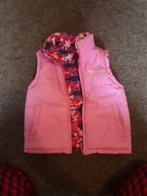 Girl's gillet age approx 4. Reversible bright pink and other side purple and pink dinosaurs