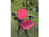 Office swivel chair, unknown manufacturer, red fabric seat, adjustable arms.