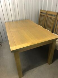 Light Oak extendable Dining table in perfect condition with 6 upholstered dining chairs to match