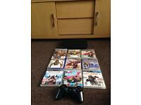 PlayStation 3 with controller and games