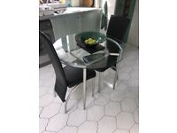 Glass table leather chairs
