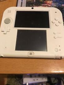 2DS white and red with game.