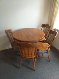 Pine dresser table and chairs .