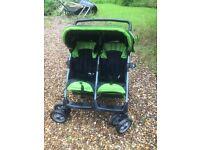 A black double buggy / stroller