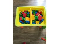 Water, sand table with tools and duplo bricks