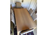 Oak dining table with 6 chairs in good condition for sale