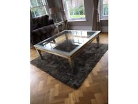 Large silver and gold leaf coffee table.