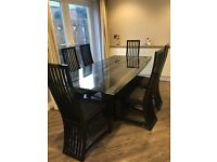 Dinning table and 6 chairs.