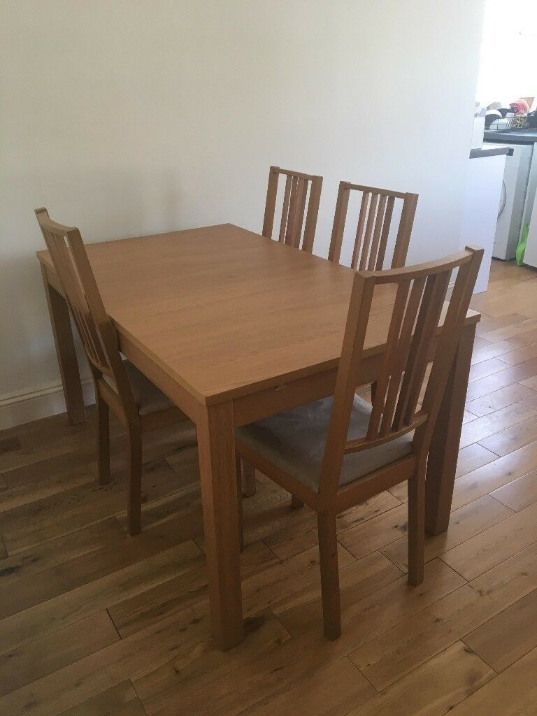 Wooden Ikea Bjursta Dining Table And Its Four Chairs