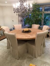 Large round light pine table with 6 chairs