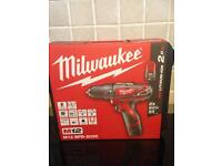 MILWAUKEE M12BPD 202C COMBI DRILL. AS NEW. SELL OR SWAP FOR PETROL LAWNMOWER