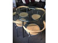Round Glass Dinning table with 4 chairs