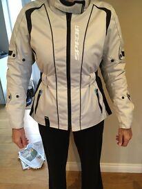 Ladies Spada biker jacket and LS2 helmet, good as new. Worn 3 times