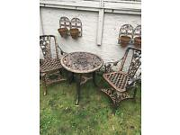 Bronze garden table and chairs