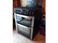gas cooker in black glass in as new condition,60cm and still in shops,flexi pipe already fitted.