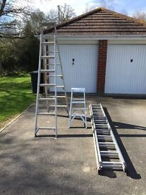 Three ladders, one extension one step/ leaning ladder and three rung step ladder