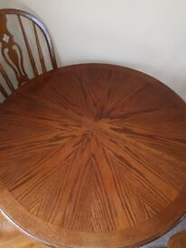 Solid table and 4 chairs. Extendable. Excellent condition