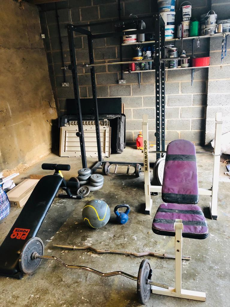 Home Gym Equipment Including Bars Weights Squat Rack Bench Press
