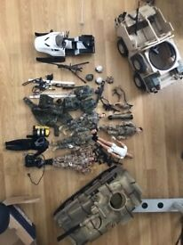 Used action figures with accessories and vehicles