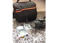 Canon EOS 100D Bridge SLR with 15-88 mm lenses and polarise filter