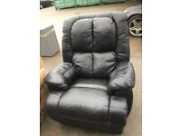 Black leather electric reclining chair.