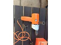 Vintage Black and Decker drill with attachments lathe, sander, saw.