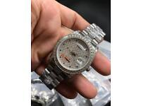 Silver diamond iced out Rolex not Cartier hublot watch