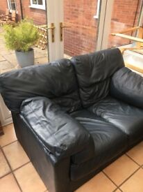 Dark blue leather small 2 seater sofa. Good condition