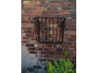 Old iron hay basket