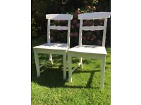 2 White wooden chairs