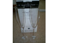 Pair of Dartington crystal slim champagne flutes. Boxed and unused. Signature series.
