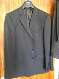 Excellent condition pinstripe 2 piece suit. Only worn a couple of times. Machine washable.