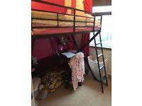 Black metal cabin bed with underneath desk
