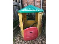 Plastic playhouse with opening door and window