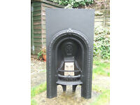 A LOVELY LITTLE RECLAIMED CAST IRON FIREPLACE