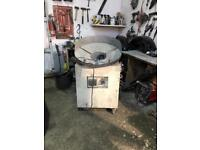 Alloy wheel painting/extraction machine