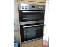 Electric induction hob and double electric oven.