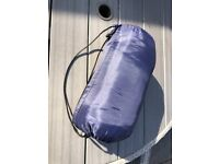 Lightweight blue envelope sleeping bag with carry bag