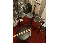 Alesis DM Lite Electronic Drum Kit With Sticks and Throne aka Stool which is new.