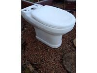 Used toilet with soft closing lid. No cistern
