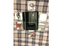 PlayStation 3 With 8GB & 6 Games