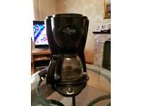 DeLonghi black coffee maker