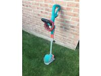 Bosch CombiTrim Lawn trimmer (strimmer) and edger. Includes spare line.