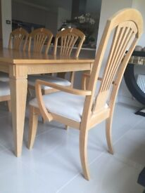 Extending dining table with chairs