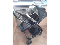 Black pushchair with carry cot & lots of extras